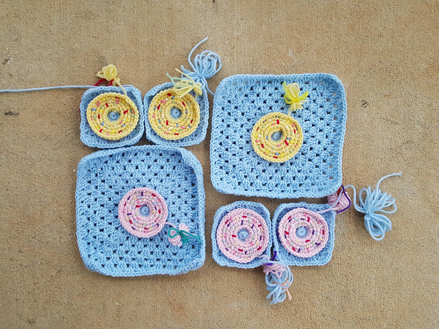 two large and four small crochet donut granny squares for a crochet purse