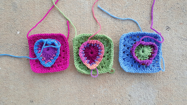 granny squares with crochet hearts