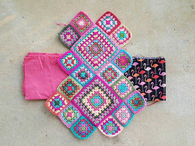 crochet squares with fabric with flamingos that inspired the crochet purse