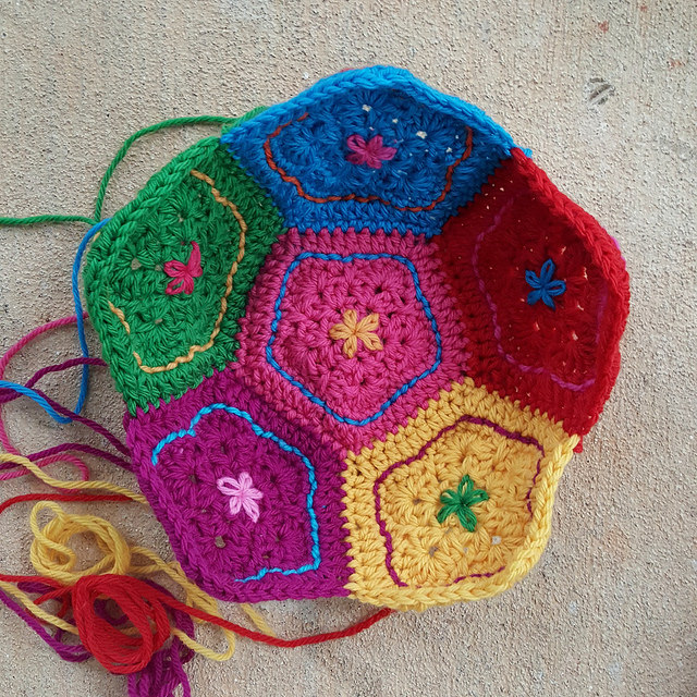 six crochet pentagons joined to form half of a crochet dodecahedron