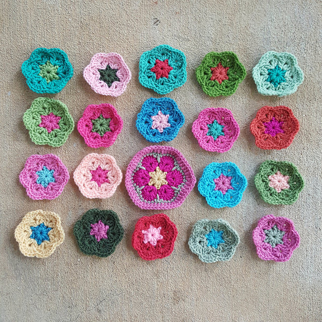 twenty african flower crochet hexagons in process