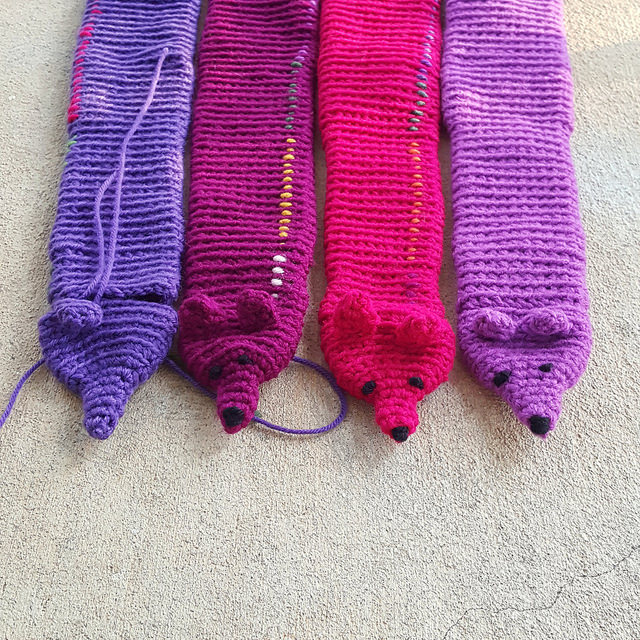 four crochet mink faces