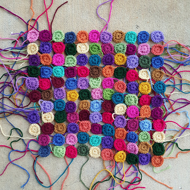 one hundred and twenty one granny squares in an assortment of colors