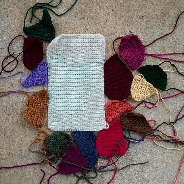 crochet crazy quilt pieces bordering a replica piece of paper worked in crochet