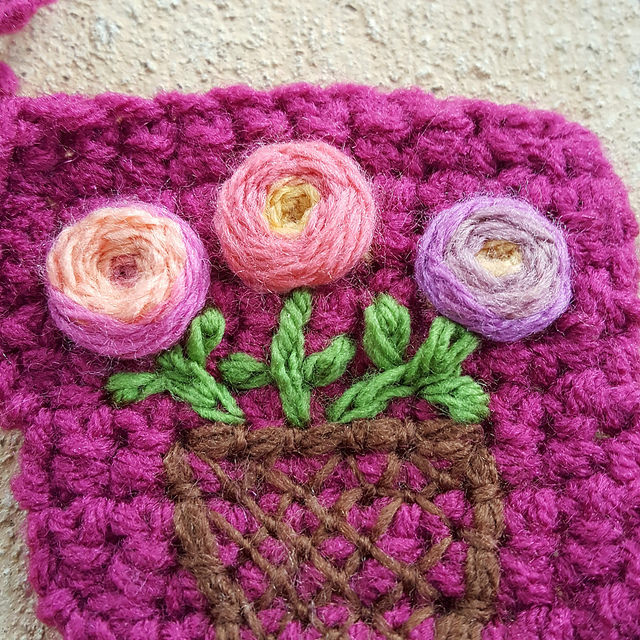 Embroidered flowers on crochet