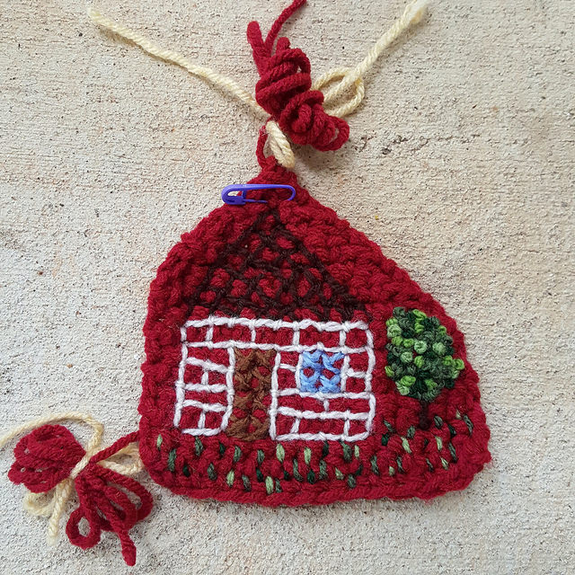 house embroidered on crochet