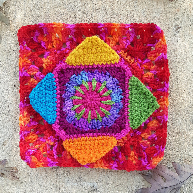 crochet square with four crochet triangle corners