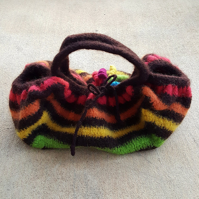 bow tie closure of a felted crochet granny square bag