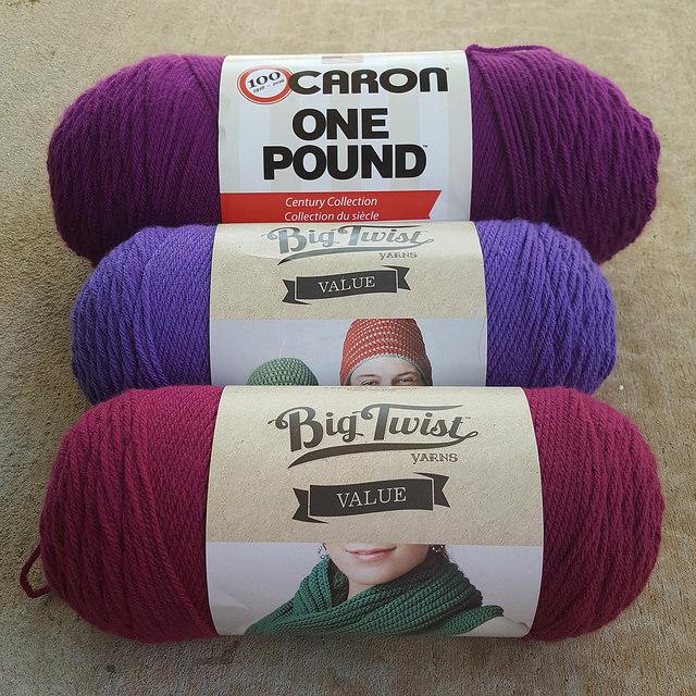 hollyhock, blueberry, and deep rose acrylic yarn