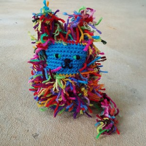 crochet cat with a hyperbolic curlicue tail