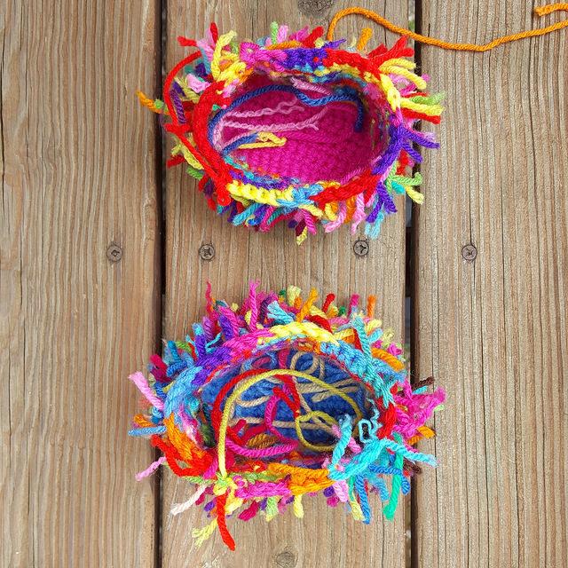 two scrap yarn crochet cats