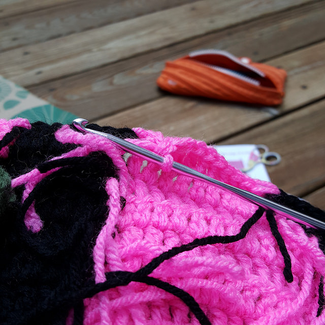 working outside on a double crochet square