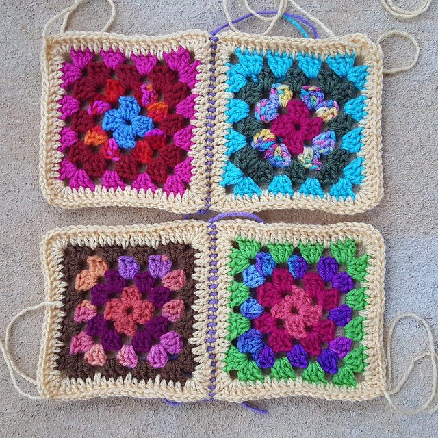 preparing four granny squares for another single crochet joining seam