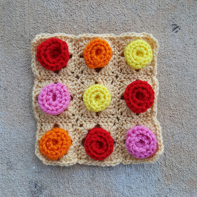 A nine-patch of roses from crochet hears and roses