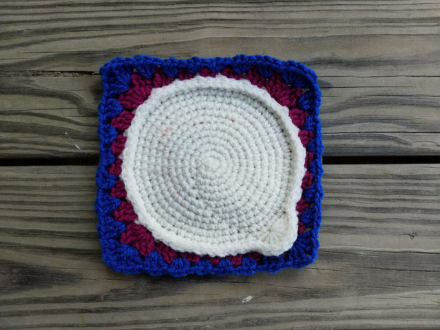 a crochet circle squared off and made into a crochet square