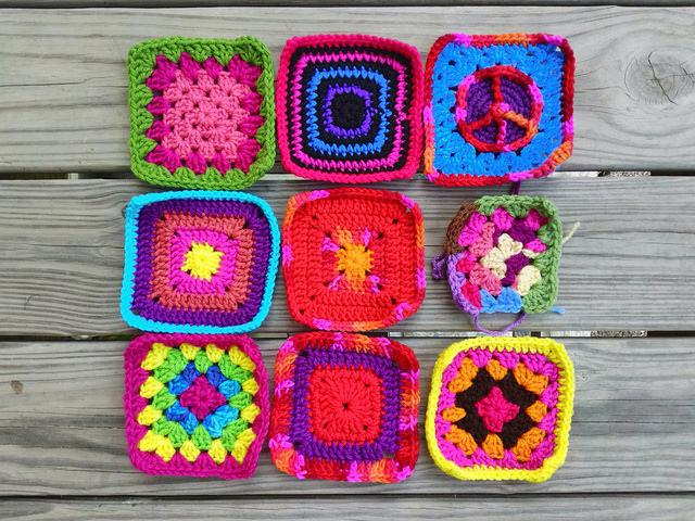 nine crochet squares including a crochet peace sign