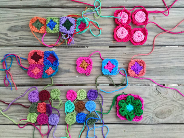 A collection of crochet remnants to be made into five inch crochet squares