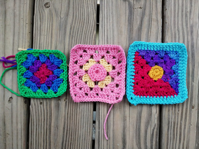 Three five-inch crochet squares in various stages of crochet rehab