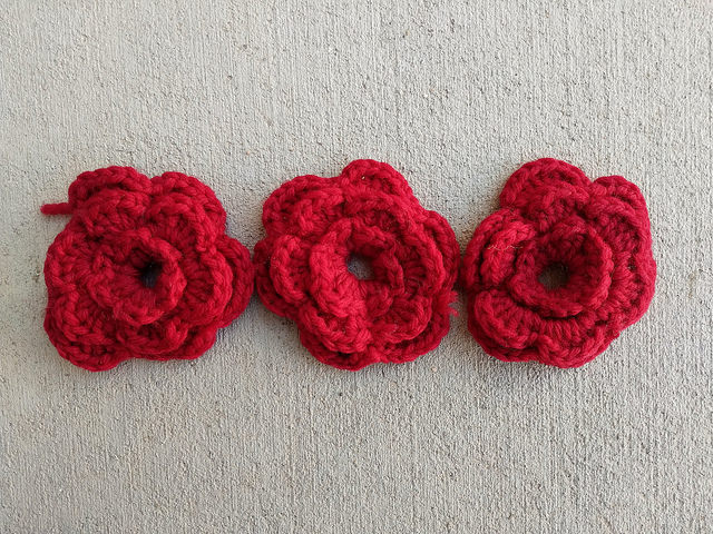 three highly textured crochet flowers
