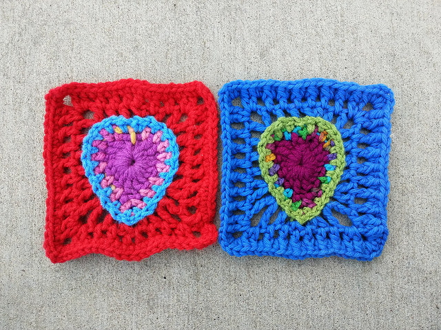 two five-inch crochet squares with crochet heart centers