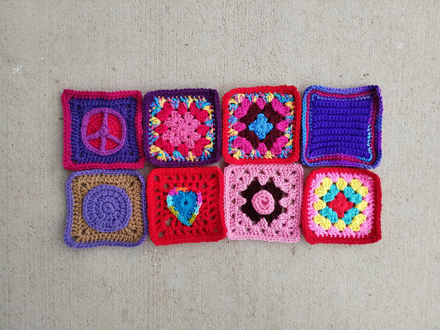 Eight rehabbed crochet squares made from assorted crochet remnants