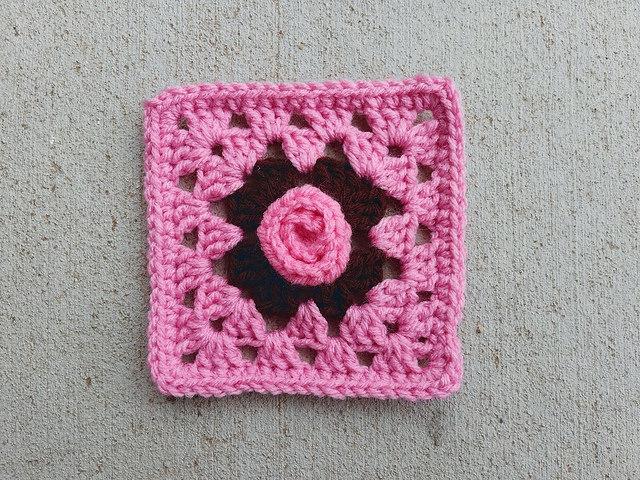 A crochet rosette rehabbed into a five inch crochet square