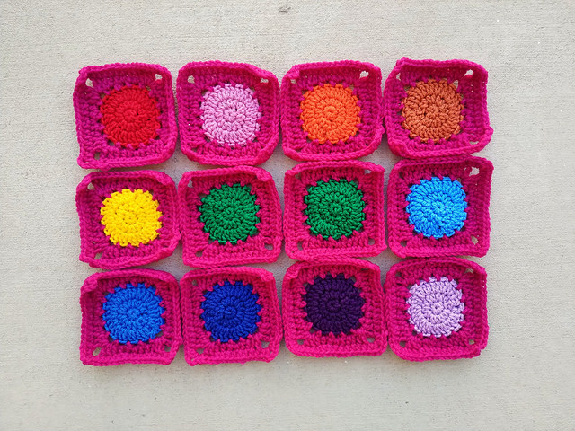 a dozen crochet circles squared off and ready for adventure