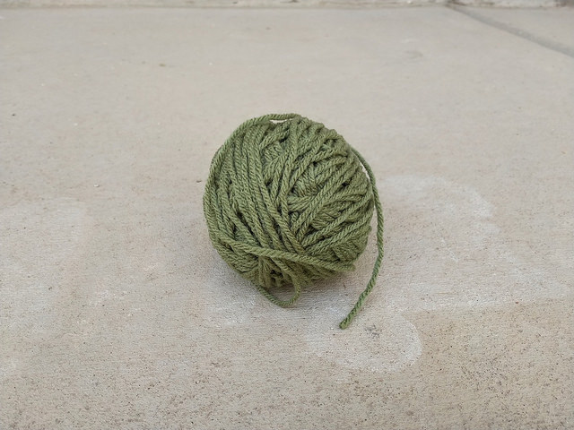 A ball of yarn of an indeterminate shade of green