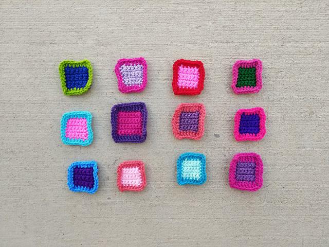 A dozen crochet remnants ready for crochet rehab