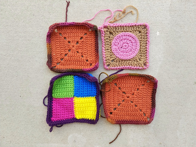 Four nearly completed rehabbed crochet squares