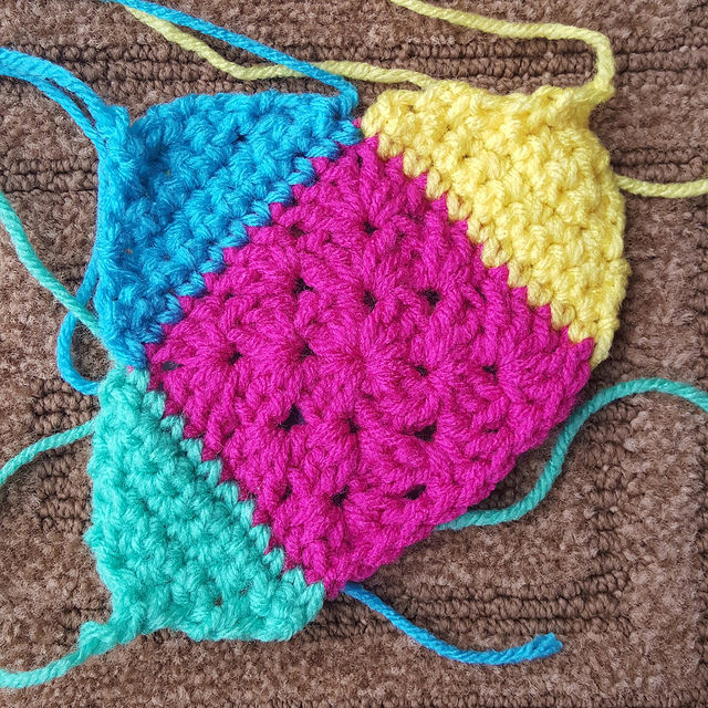 Squaring off a granny square with crochet triangles