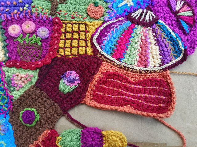 A gap in the crochet crazy quilt panel in need of a crochet linchpin
