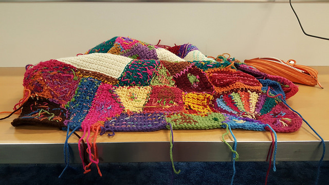 """My """"have travel"""" crochet of weaving in ends at Dallas:Fort Worth International Airport"""