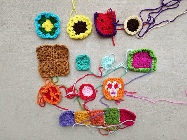 Sixteen crochet remnants ready to become rehabbed crochet squares