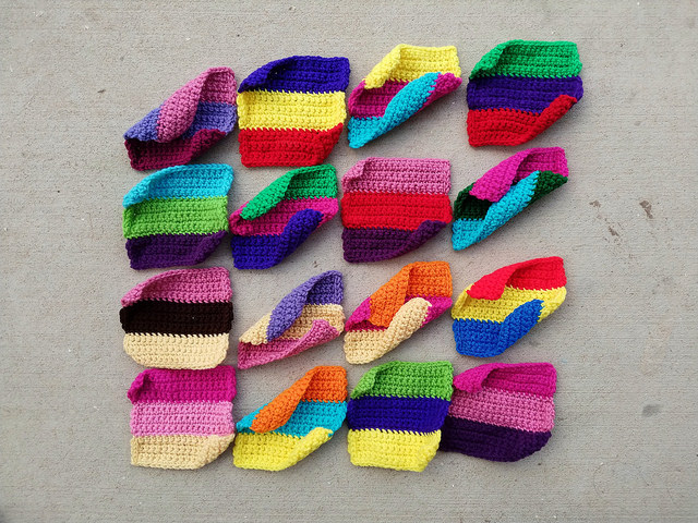 Forty-eight former crochet rectangles on the way to becoming sixteen crochet squares