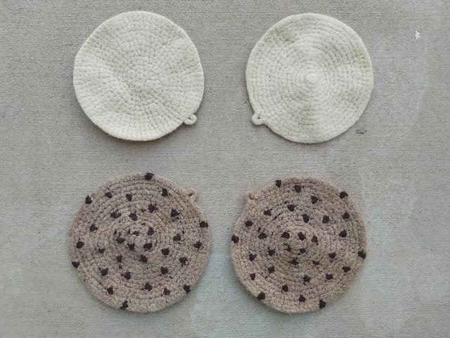 Four future felted crochet pot holders mid-felting
