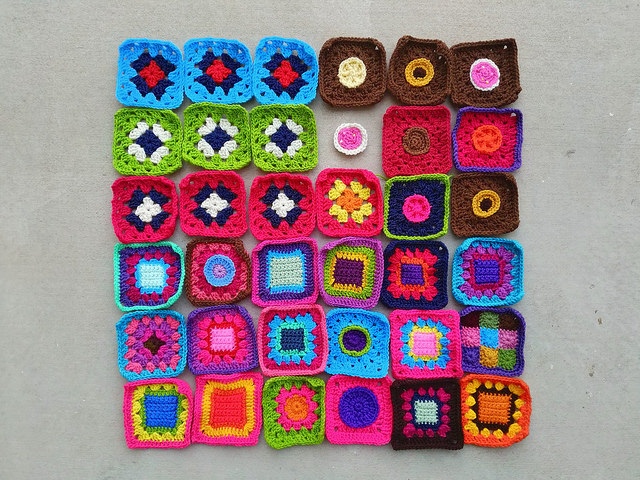 Thirty-five of thirty-six rehabbed crochet squares