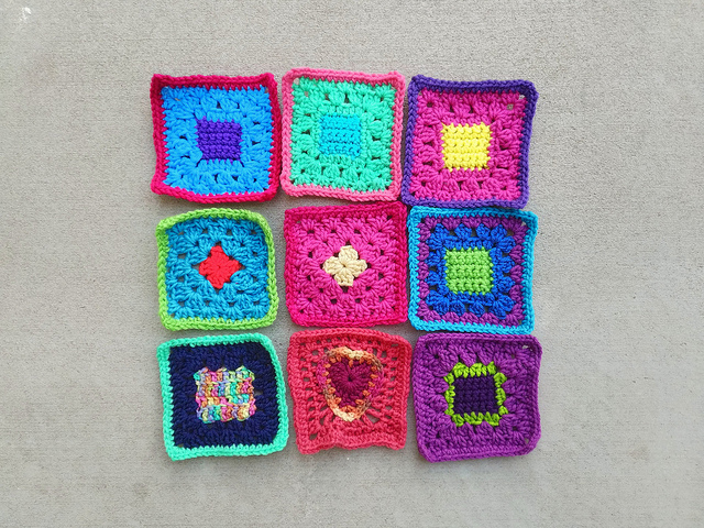 A nine patch of crochet remnants rehabbed into five-inch squares