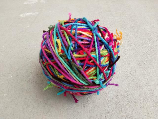 Three balls of scrap yarn transformed into one