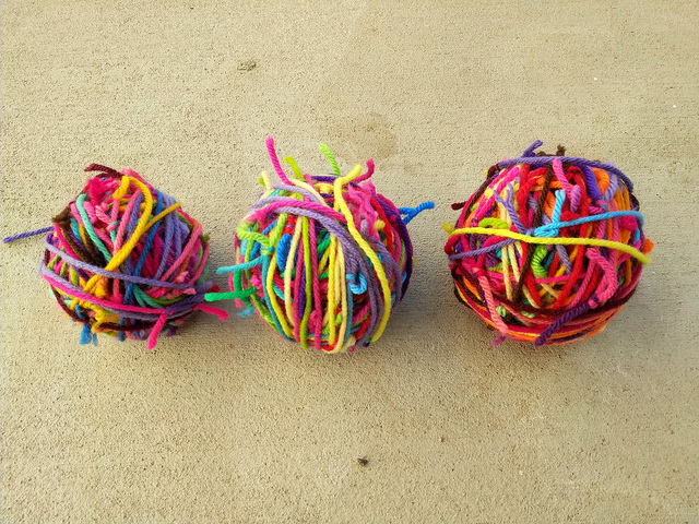 Three scrap yarn balls for my scrap yarn crochet ripple blanket