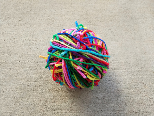Three scrap yarn balls joined into one