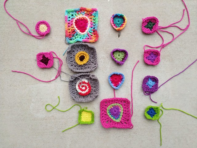 Fourteen of the sixteen crochet remnants being rehabbed