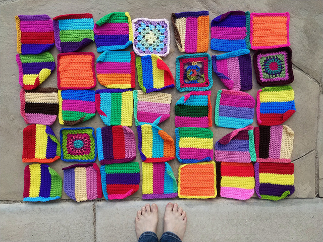 Thirty-five six-inch rehabbed crochet squares