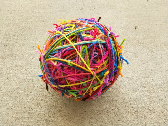 A scrap yarn ball growing ever larger and ready for adventure