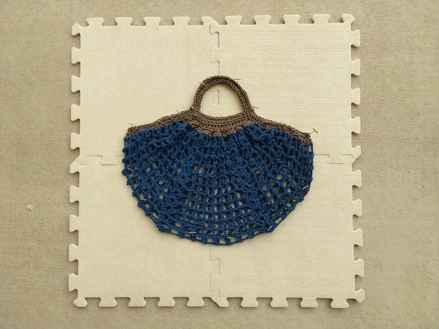The Frankston market crochet bag in the process of being blocked