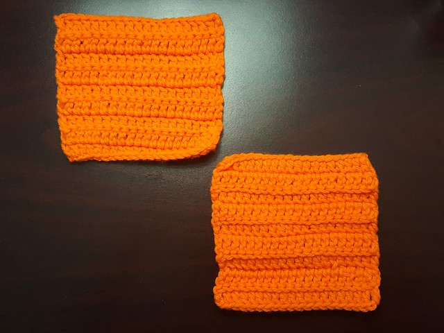Two slight textured orange crochet squares that demonstrate the power of purpose