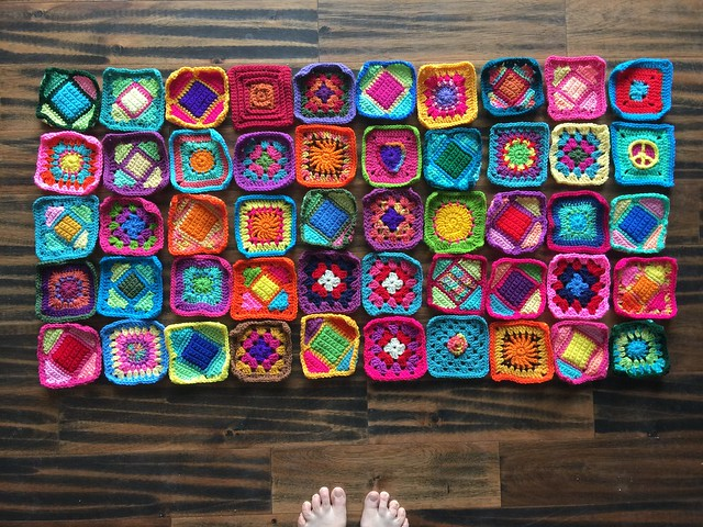 Fifty five-inch crochet squares for Project Amigo