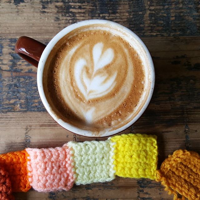 Six crochet squares and a double flat white