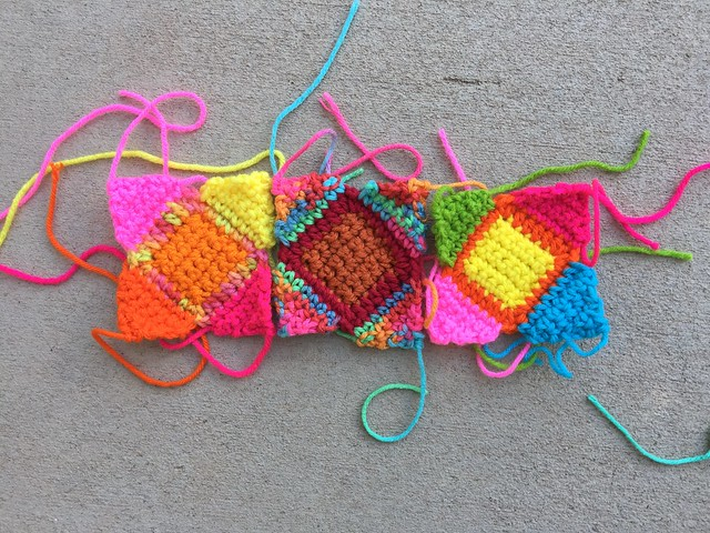 Three tilted crochet squares