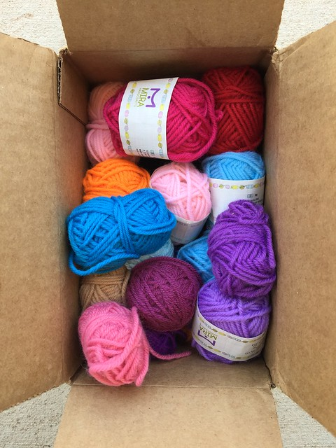 A box full of mini skeins of yarn